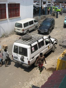 "A vehicle intended for use in a back-country part of central Africa sports two local modifications:  1) A snorkel to allow the engine to aspirate under water, for use in driving across un-bridged rivers; and 2) a large sticker on the back window indicating ""no weapons in vehicle."" (Image by Carl Friesen)"