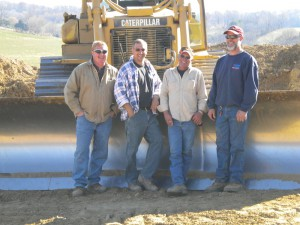 From left: Kevin Schrectengost, Adam Snover, Don Richie and Brandy Truba pose in front of a Caterpillar D-6 dozer.