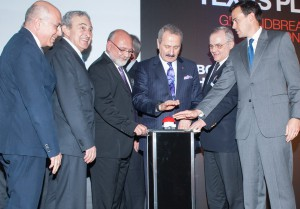"Zafer Caglayan, Turkey's minister of the economy, is flanked by Brousan officers and Texas officials during a ""virtual"" groundbreaking for the company's pipe mill, scheduled to begin operations in 2014 near Baytown."