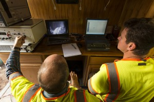 Mobile data acquisition station with analysts reviewing data
