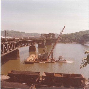 Otis crews worked on several bridge crossings over the Monongahela River near Pittsburgh on a 1970s project for Carnegie Gas. Hourly a trainload of cars carrying molten steel crossed the bridge and forced workers to climb down to escape the heat. They also installed pipe under a crossing where trains turned around.
