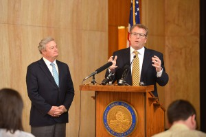 CEO Pat Hughes with Gov. Jack Dalrymple