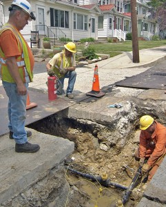 UGI workers install replacement pipe on a residential street in in Pottsville, PA.