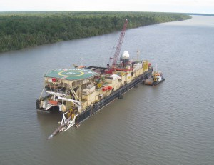 The offshore installation vessel installing the shallow-water portion of the offshore pipeline.